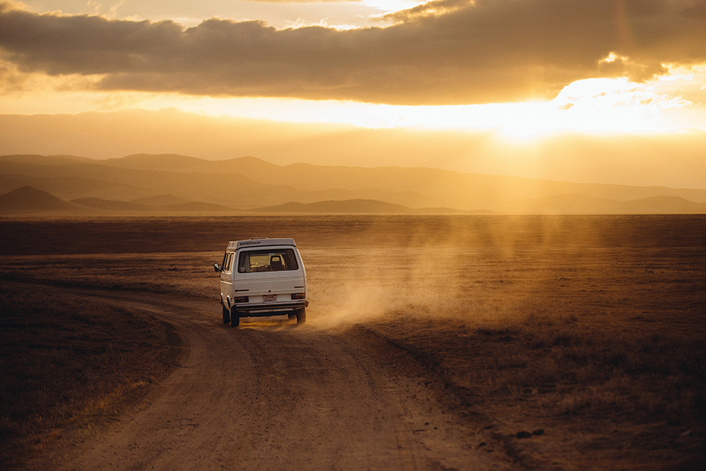 Purpose: It's like gas in a car (except way less expensive). | Image shows a old van driving through the desert as the sun sets in the background.