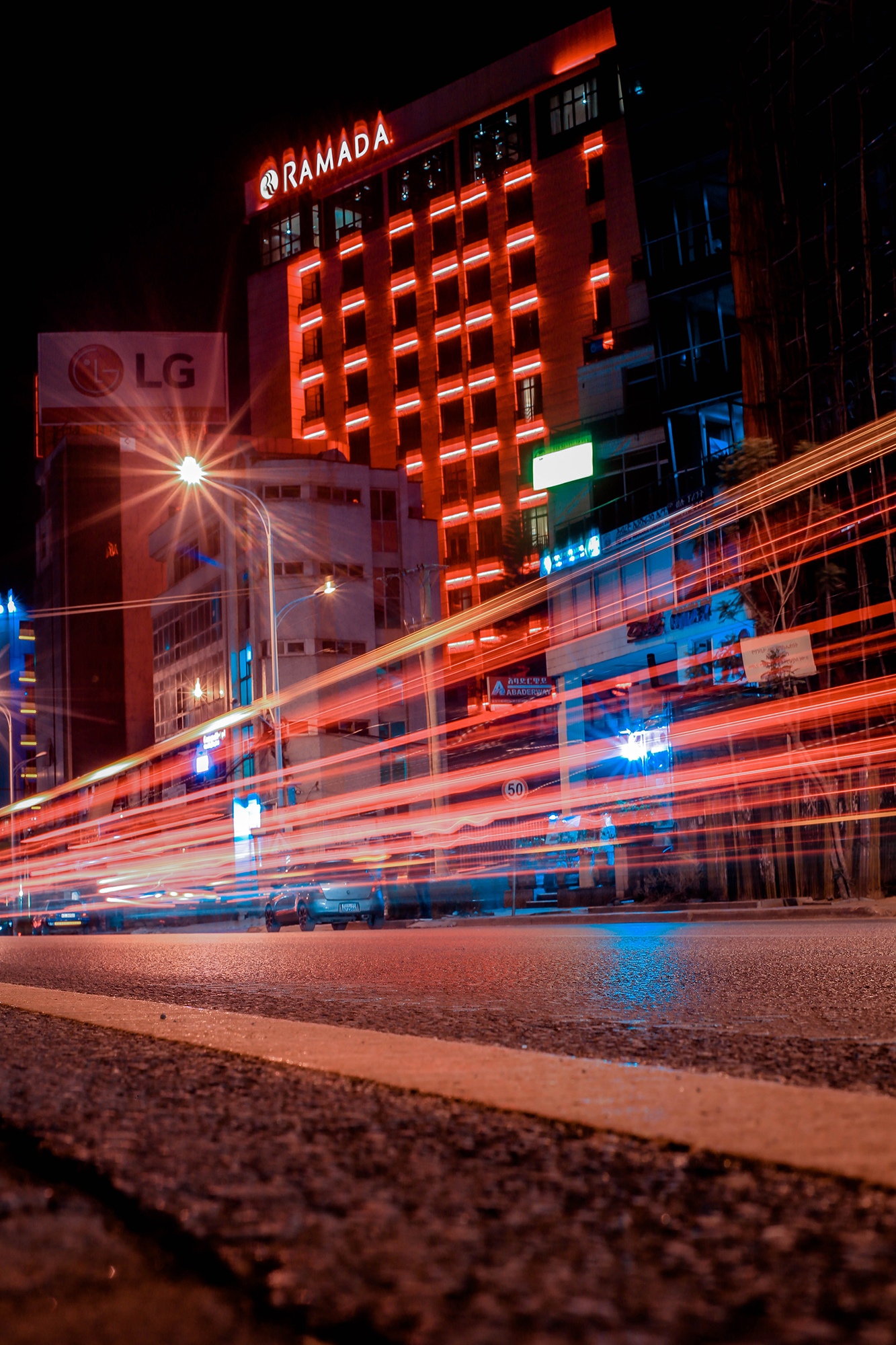 Addis Abeba, Ethiopia at night with red & blue lights created by a time lapse of passing cars.